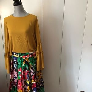 Round neck blouse with bell sleeves.